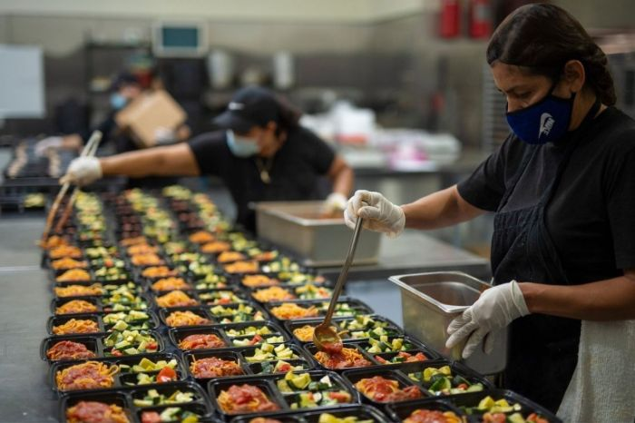 Photo for: LA restaurants owners prepare meals for seniors